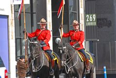 RCMP riding in Saint Patrick's Day parade, Ottawa, Canada. OTTAWA, CANADA - Mar. 10, 2012: RCMP riding in Saint Patrick's Day Parade in Ottawa, Canada Royalty Free Stock Photography