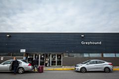 Main building of the Ottawa Coach Station with the greyhound logo and taxis waiting. stock image