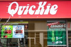 Quickie logo in front of their store in downtown Ottawa, Ontario. stock photos