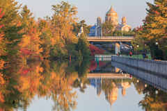 Ottawa Canal and fall colors. Ottawa canal in the fall with Ukrainian Catholic Shrine in the background royalty free stock images