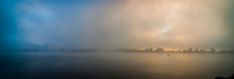 Ottawa city skyline on a dense fog morning on the Ottawa River. Royalty Free Stock Image