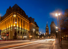 Ottawa Downtown. A view of the Ottawa post office building and the tower of the parliament buildings on a twilight evening with light streaks from automobiles Royalty Free Stock Image