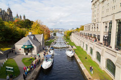Ottawa Locks. OTTAWA, CANADA - 12TH OCTOBER 2014: Ottawa Locks along the Rideau Canal during the day. Boats and people can be seen stock photo