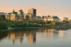 Ottawa morning. Ottawa city skyline at sunrise in the morning over river with urban historical buildings and colorful cloud Royalty Free Stock Image