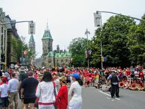 The streets of downtown Ottawa are packed with thousands of families and multicultural people celebrating Canada Day royalty free stock photo