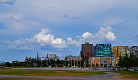Ottawa, Ontario, Canada View of the central tower of the Parliament of Canada by LeBreton Flats Park royalty free stock photography