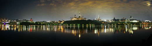 Ottawa Parliament at Night. The Parliament buildings in Ottawa viewed over the Ottawa River at night stock photos