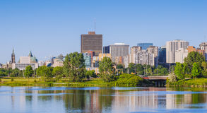 Ottawa River and capitol city skyline along the parkway - late springtime afternoon - early evening approaches. Royalty Free Stock Photo