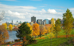 Ottawa River and capitol city skyline along the parkway - pedestrian path on sunny afternoon. Stock Photography