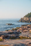 Otter Cliffs in the background with slabs of Pink Granite Rocks Royalty Free Stock Images