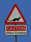 Otter, die Zeichen kreuzen Lizenzfreie Stockfotografie