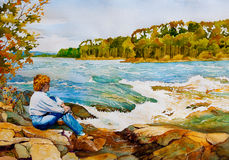 Otter Rapids. An original watercolor painting of a middle-aged woman sitting on the rocks by Otter Rapids near Lac La Ronge, Saskatchewan, Canada in Autumn Stock Photo