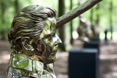 Mystical sculptures by Jan Fabre under the name CHAPTERS I - XVIII. Park De Hoge Veluwe. Otterlo. Netherlands. Otterlo, The Netherlands - May 2, 2018: Polished royalty free stock images