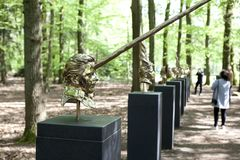 Mystical sculptures by Jan Fabre under the name CHAPTERS I - XVIII. Park De Hoge Veluwe. Otterlo. Netherlands. Otterlo, The Netherlands - May 2, 2018: Polished royalty free stock photography