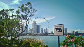 Otters crossing sign. Signpost that advises people to not approach otters at Marina Bay, Singapore Stock Photography