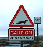 Otters Crossing Sign. An unusual road warning sign for otters crossing the road, on the Isle of North Uist, the Western Isles (Outer Hebrides) of royalty free stock photography