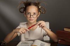 Otto anni della ragazza con i libri Fotografie Stock Libere da Diritti
