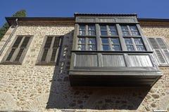Ottoman building in historic quarter of Antalya, Kaleici. Antalya, Turkey – February 8, 2016. Wooden balcony and shuttered oriel windows of an Ottoman Stock Photos