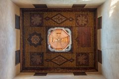 Ottoman era decorated wooden ceiling with floral pattern decorations and wooden dome, Cairo, Egypt. Ottoman era decorated wooden ceiling with floral pattern royalty free stock images