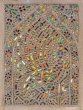 Ottoman era style glazed ceramic tiles from Iznik Turkey decorated with floral ornaments. Perforated stucco window decorated with colorful stain glass with Royalty Free Stock Image