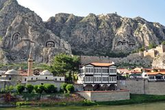 Ottoman houses of Amasya. View from the river of the riverfront Ottoman houses and the tombs of the Pontus kings carved into the rocky cliffs overhead, in the Stock Images