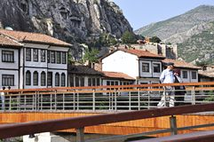 Ottoman houses and people walking on the bridge in Amasya, Black Sea region of Turkey royalty free stock images