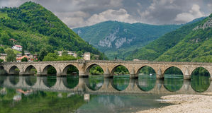 The Ottoman Mehmed Pasa Sokolovic Bridge, Visegrad. The Ottoman Mehmed Pasa Sokolovic Bridge in Visegrad, Bosnian mountains, with fantastic sky scape and river Royalty Free Stock Photography