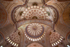 OTTOMAN MOTIF ON THE INTERIOR OF A DOME. A combination of floral and calligraphy motif on the interior of a dome of the Blue Mosque in Istanbul, a public place stock image