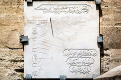 Ottoman Sundial for prayer. Ottoman sundial scraped on marble for pray times. Sundial hanged on Uskudar Mihrimah Sultan Cami (mosque) wall in Istanbul Turkey Royalty Free Stock Images