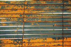 Otturatore grigio ed arancio stagionato Immagini Stock Libere da Diritti