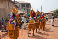 Masquerade in Nigeria. People dressed up and celebrating at the Age Grades ceremony or festival in Otuo, Nigeria, Africa. rear view Royalty Free Stock Image