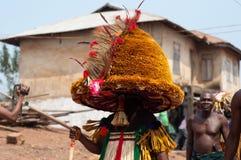 Masquerade in Nigeria. Otuo Age Grades Festival - Otuo is made up of 12 quarters namely : Amoya,Ohigba,Oluma,Amoho,Olila,Orake,Obo,Uree,Imafen,Iyeu,Iziokhai Stock Photos