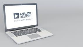 Otwarcia i przymknięcia laptop z Analog Devices logem 4K 3D redakcyjny rendering Zdjęcie Royalty Free