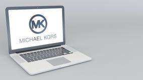 Otwarcia i przymknięcia laptop z Michael Korso logem 4K 3D redakcyjny rendering Zdjęcie Stock