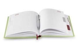 Otwarta dziennik zieleń z srebnym piórem Fotografia Stock