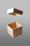 Otwiera kwadratowego pudełko w odosobnionym tle Fotografia Stock
