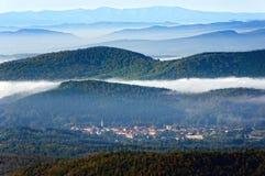 Otxandio village surrounding by foggy mountains Stock Photography