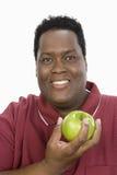 Otyła mężczyzna mienia zieleń Apple zdjęcie stock