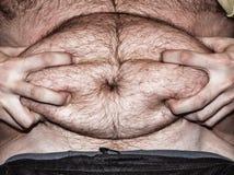 Otyłość - gruby brzuch Obrazy Royalty Free