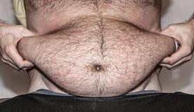 Otyłość - gruby brzuch Fotografia Royalty Free