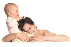 Ouch!. A few months old baby boy is pulling his mother's hair royalty free stock photo