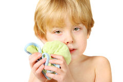 Ouch. An injured boy holding an ice pack on a swollen lip and cheek stock photos