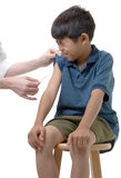 Ouch!. Young boy about to get immunized royalty free stock photo