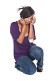 Ouch I am hurt. Mixed race girl with a hurt elbow sad face stock images