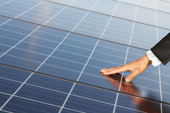 Ouch renewable energy systems. Business Hand touch renewable energy systems and the earth stock images