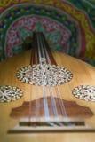Oud closeup. Egyptian oud on Islamic fabric background Royalty Free Stock Photos
