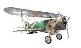 Oud die vechtersvliegtuig op witte achtergrond met wegen wordt geïsoleerd royalty-vrije stock afbeelding