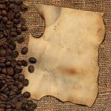 Oud document met koffiebonen van het ontslaan Royalty-vrije Stock Afbeeldingen