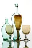 Oud fles en het drinken glas Stock Afbeelding