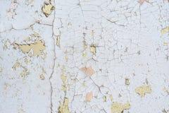 Oud gebarsten verfpatroon op muur Stock Afbeeldingen
